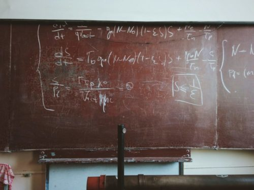 blackboard showing equations and formulas.
